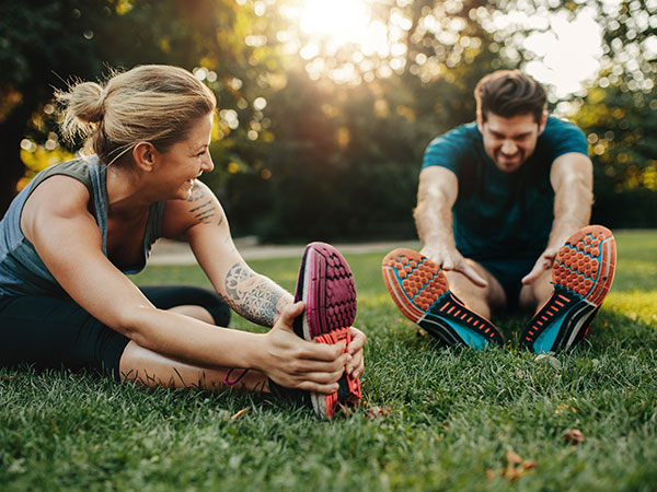 couple stretching after run